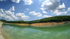 High mountain Lake with blue sky Cloudscape wide angle Time Lapse - stock footage