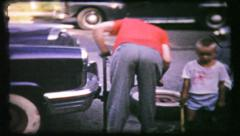265 - dad changes flat tire - vintage film home movie Stock Footage