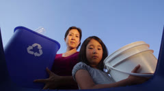 Sustainability - Mother and Daughter Recycle Plastic Bottles Stock Footage