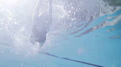 View from underneath of a professional female swimmer underwater Stock Footage