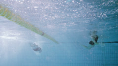 Underwater view of 2 professional female swimmers racing Stock Footage