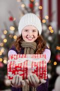 Winter child with christmas gifts Stock Photos