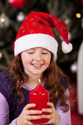 Little girl holding the Christmas candle Stock Photos
