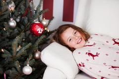 Girl lying waiting for the christ child Stock Photos