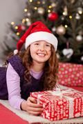 Young girl on Christmas Eve Stock Photos