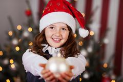 beautiful young girl in a santa hat - stock photo