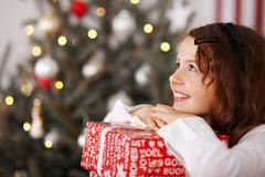 Pretty young girl dreaming of christmas Stock Photos
