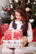 Little girl looking at her christmas gifts Stock Photos