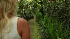 Girl walk in garden Stock Footage