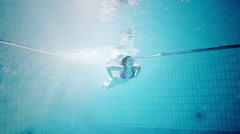 Happy and attractive family swimming together underwater Stock Footage