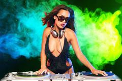 Beautiful woman being a DJ - stock photo