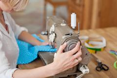 work on sewing machine - stock photo