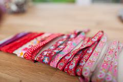 various laces wrapped on table in workshop - stock photo