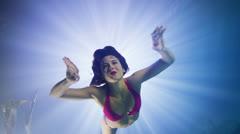 Beautiful mysterious underwater woman in pink bikini Stock Footage