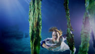 Stock Video Footage of Beautiful mysterious underwater woman in white dress