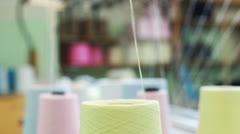 Twisting thread from bobbin on weaving loom Stock Footage