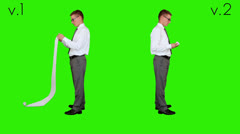 Young businessman reading a long bill, Green Screen Stock Footage