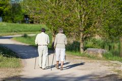 elderly couple wandering in the park together - stock photo
