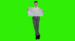 Young businessman reading a map and sitting, Green Screen Stock Footage