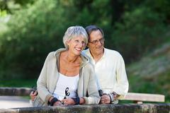 senior couple looking away while hiking - stock photo
