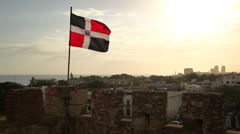 Dominican Republic flag over city Stock Footage