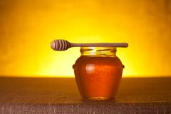 honey jar with dipper - stock photo