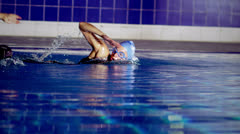 3 professional female swimmers in training - stock footage