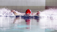 Male swimmer in training doing the butterfly stroke  Stock Footage