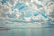 Stock Photo of dramatic sky over Garda lake with pier - Italy