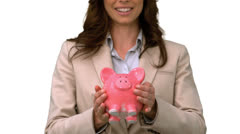 Businesswoman throwing a piggy bank on white screen Stock Footage