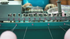 Work of machine for knitting baby's pompoms Stock Footage