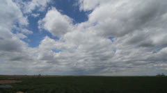 Slow time lapse of moving clouds over plains Stock Footage