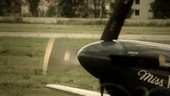 German combat plane with propeller and swastika steers airport Stock Footage