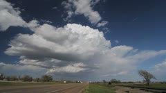 Clouds rise over a highway leading to Dodge City Stock Footage