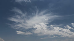 Two types of clouds in a blue sky Stock Footage