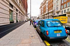 row of taxis in front of Marble Arch, London, UK - stock photo