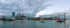 Modern London cityscape with HMS Belfast and Union Jack Stock Photos