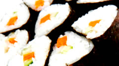 Sushi rolls with green stems Stock Footage