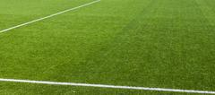 White stripe on the green soccer field Stock Photos