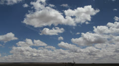 Cumulous clouds move rapidly over the sky Stock Footage
