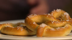 Salted Pretzels Spinning On Plate HD Video - stock footage