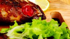 Roast golden fish Stock Footage