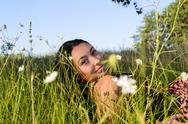 Stock Photo of The girl in the grass