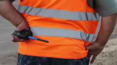 Clumsy fat male security with walky-talky in orange uniform Stock Footage