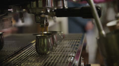 Close up of a coffee machine and female barista serving customers  Stock Footage