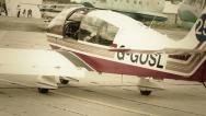 Steering war airplane with propeller on ground at airport Stock Footage