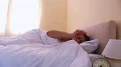 Woman waking up going to open curtains Stock Footage