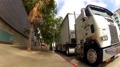 POV Rolling By Movie Crew Trucks On Location In Downtown L.A. Stock Footage