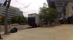 POV Of Movie Crew Trucks In Front Of Caltrans Building in L.A. Stock Footage