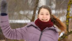 Crazy girl turns around many times in cold winter Stock Footage